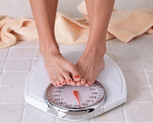 وزن زائد - ميزان - السمنة